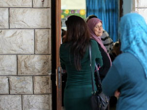Lining Up: Israeli Arabs wait to vote in elections. Those that voted said they did so reluctantly, with little hope of change emerging from what they branded a ?Jewish game.?