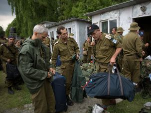 Israeli soldiers set up camp in earthquake-ravaged Nepal as stranded trekkers pleaded for more help.