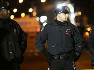 Men in the Middle? New York police officers guard scene after two colleagues were shot execution-style by a man who spewed anti-police rage. How do Jewish cops deal with the rift between the men in blue and some of the communities they patrol?