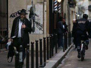 On Alert: Police patrol a Jewish neighborhood in France.