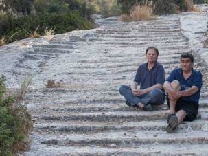 Roads Lead to Jerusalem: Yigal and Yotam Tepper sit on rock-hewn steps. They believe Second Temple-era roads were built by Jews, not Romans.