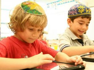 iKids: Students work on the first day of school at the Saul Mirowitz Community School in St. Louis