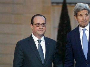 Wanted Man: John Kerry, who took criticism for not attending last weekend's march against terror, greets French President Francois Hollande.