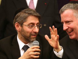 Manhattan Meeting: France's Chief Rabbi Haim Korsia chats with New York Mayor Bill De Blasio at Park East Synagogue.