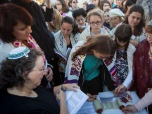 Teenage Pioneer: Bat mitzvah girl Sasha Lutt reads from a tiny Torah scroll smuggled into the Western Wall.