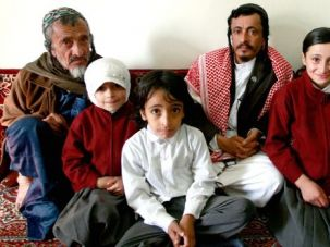Jewish Remnant: Yemeni Rabbi Yahia Yussef Mussa (C), sporting a checkered keffiya, poses for a picture with his father, Rabbi Yussef, his daughters and other unidentified relatives at his apartment in the Yemeni capital Sanaa on January 18, 2010.