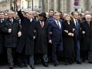 Symbolic Moment: French President Francois Hollande is surrounded by heads of state including Israel's Prime Minister Benjamin Netanyahu (left) and Palestinian President Mahmoud Abbas (right) at the solidarity march in Paris.