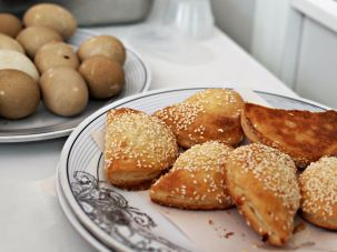 Bourekas filled with cheese are eaten with hard-boiled eggs for breakfast.
