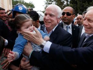 Slappy Joe? Riot police and the FBI intervene as former senator Lieberman reaches gleefully for a young child in Bristol, Conn.