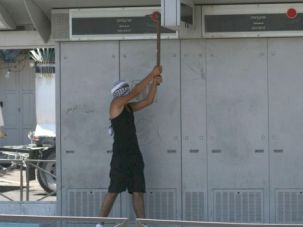 Mad as Hell: Enraged Palestinian protester uses a pick-axe to damage Jerusalem light-rail station.