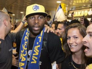 Cheers to You: American Tyrese Rice wades through sea of rapturous supporters after Maccabi Tel Aviv won Europe's basketball crown.