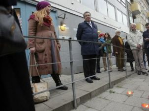No Surrender: Jews and supporters gather outside a community center in Malmo, Sweden that was hit by a firebomb attack.