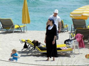 An Orthodox Jewish woman takes in some sun in Miami.