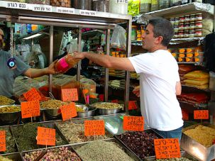 Chef Michael Solomonov, here in Levinsky Market in Tel Aviv, sampled foods from across Israel.