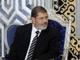 Bump in Road? Egyptian President Mohamed Morsi is moving to assert himself by firing some holdovers from the old regime.