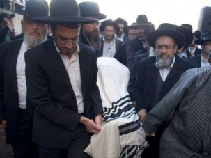Rabbi Moshe Twersky is laid to rest by ultra-Orthodox Jews after the terror attack on a Jerusalem synagogue.