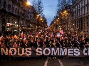 Nous Sommes Charlie: Demonstrators make their way along Place de la Republique during a mass unity rally following the recent terrorist attacks in Paris.