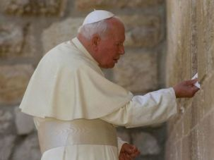Message of Tolerance: Pope John Paul II, shown here at the Western Wall, is credited with dramatically improving relations between Catholics and Jews.