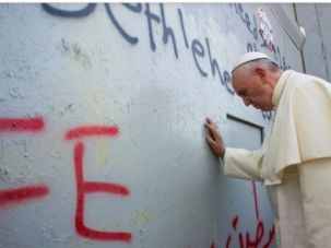 Hello Palestine: Pope Francis prays at Israeli separation wall in Bethlehem.