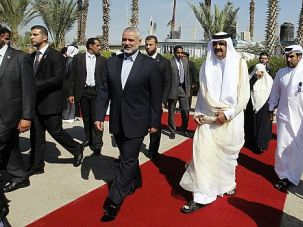 Red Carpet in Sand: The emir of Qatar is greeted by Gaza?s Hamas leaders.