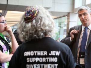 Presbyterian Protest: Demonstrators calling for action against Israel confront Rabbi Rick Jacobs at the Presbyterian Church's recent convention.