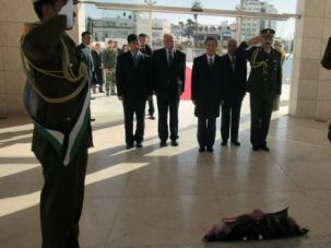 Feuding Fatah: Palestinian and visiting Chinese dignitaries lay wreath at memorial to late leader Yasser Arafat. A simmering feud among top Fatah officials erupted during the visit, forcing the elite presidential guard to intervene.