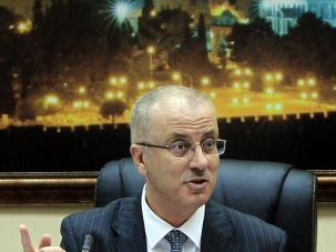 New Deal: Palestinian premier Rami Hamdallah discusses unity government at Ramallah press conference.
