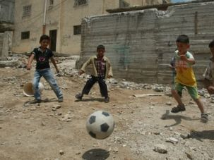 Generation After Generation: Palestinian children play in a West Bank camp. Some believe only those personally displaced in the 1948 war should be characterized as refugees, effectively excluding millions of descendents.