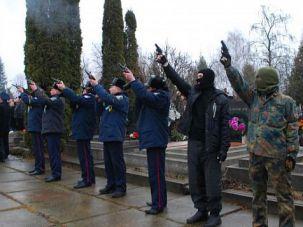 Far right wing gunmen and Ukrainian policemen at the funeral of Alexander Scherbanyuk.
