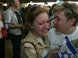 Welcome: Russian immigrant is met by relatives in Israel.