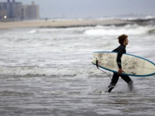 Storm Clouds: Hurricane Sandy churned up seas off New York?s Rockaway Beach. Jewish neighborhoods in south Brooklyn could be among the worst affected.