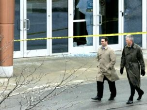 Damage Control: Kansas City officials examined the scene of a shooting at the city's Jewish Community Campus in April, 2014.