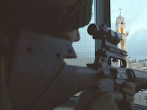 All Along the Watchtower: An IDF sniper keeps watch over the town of Bethlehem.