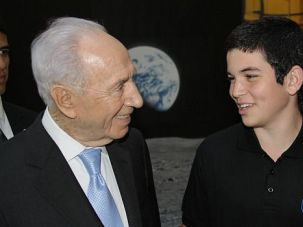 Over the Moon: Shimon Peres, Israel?s notoriously tech-happy president, greets teen space science whiz Amit Levin, who is part of a team trying to launch an Israeli space craft to the moon.