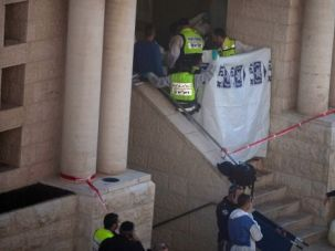 Deadly Shul: Emergency personnel block entrance to Jerusalem synagogue where at least four people were killed by terrorists.