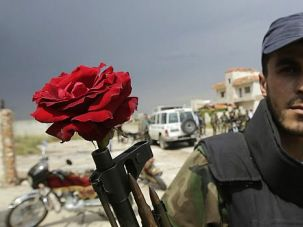 No Peace: Syrian rebel fighter prepares for battle with government forces and their Hezbollah allies.