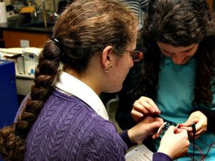 Solving Electrical Problems: Students work on engineering projects as part of the CIJE initiative.