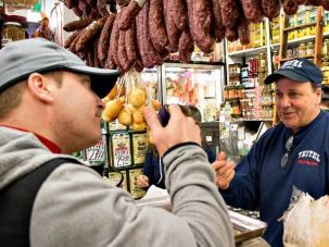 Michael Teitel (right) offers an osso buco recipe to Giancinto (left), an Italian restaurant owner and executive chef, who comes to the store twice a week for grocery shopping and inspirations.