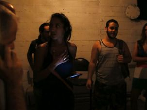 Women and men mix in a Tel Aviv bomb shelter. A more conservative city of Ashdod was ordered to stop segregating shelters by gender.