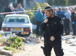 Israeli policeman guards scene of a bus stabbing in Tel Aviv.