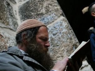 Uneasy Balance: A Jewish man prays near an entrance to the Temple Mount. Right-wing Israelis are demanding access to the holy site, which could tip an uneasy balance between faiths.