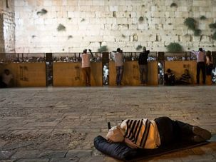 Sharing the Holy City: Observant Jews pray in mourning for Tisha B?Av at the Western Wall