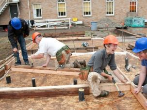 Power Tools: Participants in Tivnu?s week-long program, a predecessor to the gap year, saw lumber for a housing project.