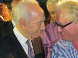Rubbing Shoulders: The author (right) meets Israeli president Shimon Peres.