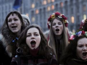 Song of Hope: Ukrainian teenagers sing the country?s national anthem in Kiev?s Independence Square.