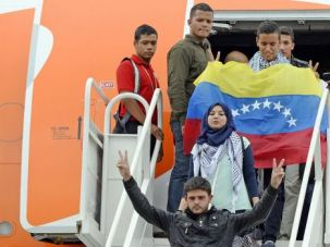 Future Doctors: Palestinian students flash the 'V' sign upon their arrival at the Maiquetia international airport in Caracas.