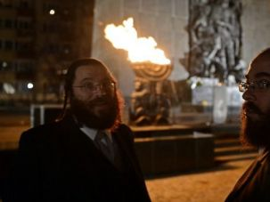 Painful Past: Two Jewish men stand in front of the monument to the fighters of the Warsaw ghetto uprising in Warsaw.