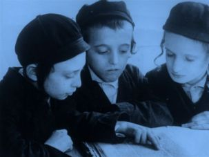 Ghetto Stories: Orthodox Jewish boys study the Hebrew Talmud in the Jewish area of Warsaw, 1938.