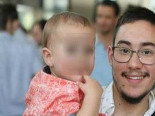 Dad and Dad: Yuval Topper-Erez, now a transgender man, holds the baby he conceived with his male partner.