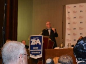 Management Doubts: Zionist Organization of America members listen to radio host Glenn Beck at the group?s 2011 gala dinner.